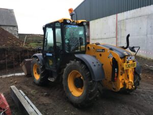 The Telehandler- our new found love! We used this to back fill the passage with clean stone pre-concrete.