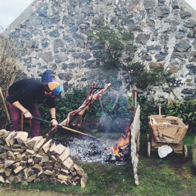 asado-bbq-fire-cooking-goat-cooking-outdoors
